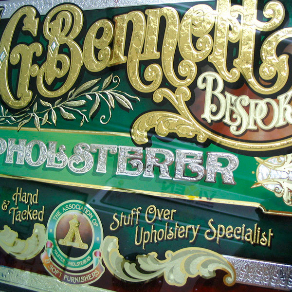 G. Bennett Upholsterer. Glass Sign