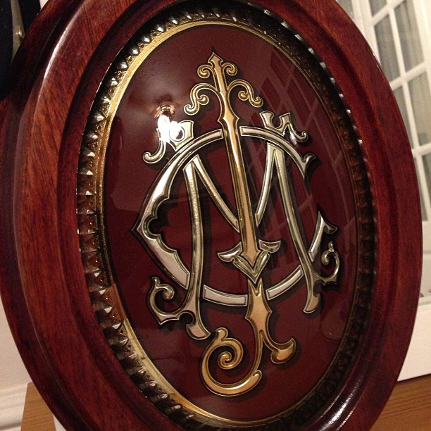 Reverse Etched and gilded glass Monogramme